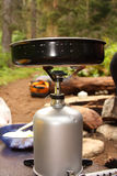 Camp Kitchen. Camp stove with flame and a frying pan royalty free stock photo