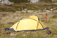 Camp in mountain. Camp in Pyrenees mountain in Andora. Small yellow tent Stock Image