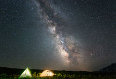 Camp in mountain with under starry night sky with  Milky Way. Tourist camp in mountain with under starry night sky with  Milky Way Stock Photography