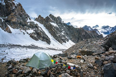 Camp in the high snowy mountains in Caucasus Royalty Free Stock Photos