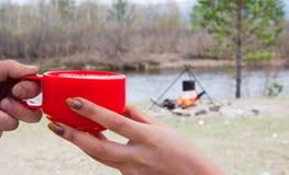 Camp mug in hands Stock Photos
