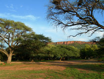 Camp in Namibia, Africa. Camp in forest at the base of rocky mountains in Namibia, Africa Stock Photography