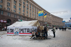 Camp with national flags on the snow street in the occupied territory by demonstrators during anti-government protest Euromaidan. KIEV, UKRAINE: Camp with Royalty Free Stock Photos
