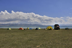 Camp near the lake. Tents in the campground near the lake Stock Image