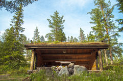 Camp resting. A resting place in the woods up on the Norwegian mountain. A small she& x27;d protecting from bad weather ready to grill royalty free stock photo