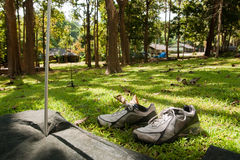 Camp site. A pair of shoes in front of a tent Stock Photos