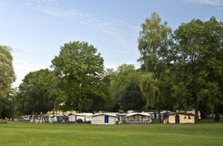 Camp site. A camp site with tents and campers under green trees. Switzerland, Schaffhausen Royalty Free Stock Images