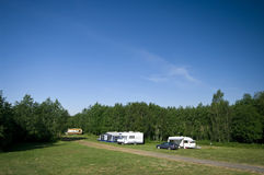 Camp site. A camp site with campers and cars in green nature Royalty Free Stock Photos