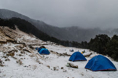 Camp Site at Nag Tibba Base. Tents during snowfall at nag tibba base camp Stock Photo