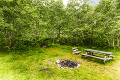 Camp site with picnic table in norwegian nature Royalty Free Stock Photos