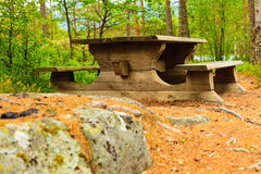 Camp site with picnic table in norwegian park Stock Image