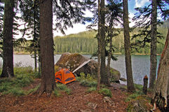 Camp site and Serene Lake, Oregon. Serene Lake campsite with tent Royalty Free Stock Image