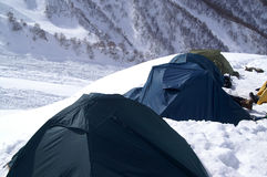 Camp in snow mountains. Caucasus. Dombay Royalty Free Stock Photo