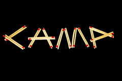 `Camp` spelled with matches, from side Royalty Free Stock Photo