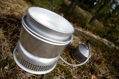 Camp Stove. A camp stove cooking water in the forest with pressurized gas Stock Photos