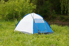 Camp tent and fishing rod on outdoor. Tent and fishing rod on outdoor Stock Images
