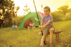 Camp in the tent - two brothers on the camping Stock Photos