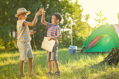 Camp in the tent - two brothers on the camping Stock Image