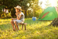 Camp in the tent - young boy on a camping Royalty Free Stock Photography