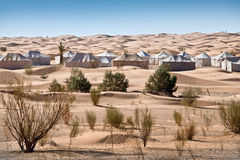 Camp of tents in a beautiful landscape of sand dunes Stock Photo