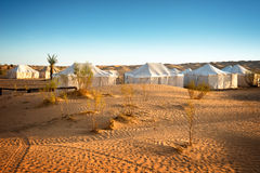 Camp of tents in a beautiful landscape of sand dunes in the desert of Sahara Stock Photo