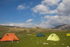 Camp. Tents in the campground in the mountains Stock Photos