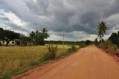 Campagna cambogiana e strada, Cambogia Fotografie Stock
