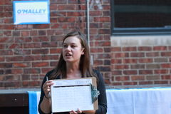 Campaign organizer holding a sign up sheet for telephone calling rallies for support at Martin O'Malley event in Des Moines, Iowa Stock Images