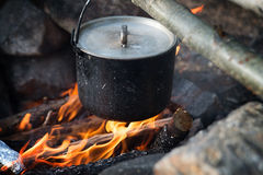 Campaign pot and fire, tourism, travelling. Outdoor Royalty Free Stock Photo