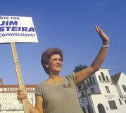 A campaign volunteer holding a sign Royalty Free Stock Photo