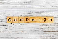 CAMPAIGN word made with wooden blocks concept.  stock photo