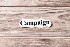 Campaign of the word on paper. concept. Words of Campaign on a wooden background royalty free stock images