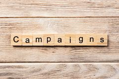 Campaign word written on wood block. campaign text on table, concept stock photo