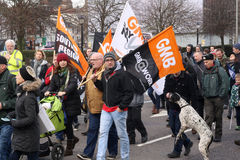 Campaigners march through Brighton, UK in protest against the planned cuts to public sector services. The march was organised by B Stock Photo