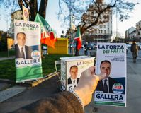 Campaigning on street of Milan, Italy for Giulio Gallera of Berlusconi`s Forza Italia Party ahead of 2018 Italian general electio. Milan, Italy - Feb 13, 2018 Stock Photos