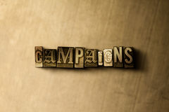 CAMPAIGNS - close-up of grungy vintage typeset word on metal backdrop Stock Photography