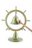 Campana de cobre amarillo con el palillo de madera Imágenes de archivo libres de regalías