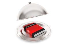 Campana de cristal de plata del restaurante con el cocinero Book Fotografía de archivo libre de regalías