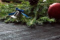 Campana de mano en una rama del abeto Fotografía de archivo libre de regalías