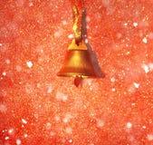 Campana de oro en fondo decorativo Imágenes de archivo libres de regalías