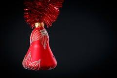 Campana di Natale con la ghirlanda rossa Fotografia Stock