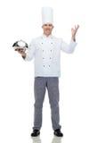 Campana di vetro maschio felice della tenuta del cuoco del cuoco unico Fotografia Stock