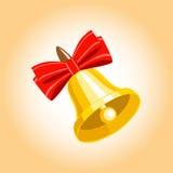 Campana dorata con un nastro rosso Immagini Stock