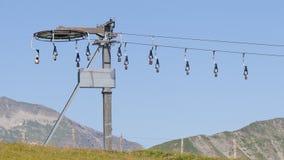 Campanaccii delle alpi su uno ski-lift Immagine Stock Libera da Diritti