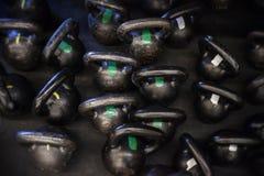 Campanas de la caldera en el piso de un gimnasio de CrossFit Foto de archivo libre de regalías