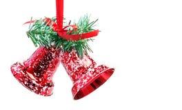 Campanas de la Navidad rojas, aisladas en blanco Fotos de archivo libres de regalías
