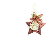 Campanas de la Navidad y accesorio de la estrella en el fondo blanco Fotografía de archivo libre de regalías