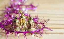 Campanas de oro con la decoración púrpura Imágenes de archivo libres de regalías