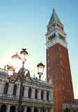Campanile di San Marco.  Venice, Italy. The Campanile di San Marco in Venice, Italy.  Bell tower.  As the sunsets in the background the bell tower is displayed Stock Photo