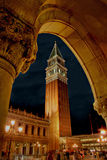 Campanile,San Marco square,venice. San marco square and the campanile tower seen through a portion of the arched portico of the doge's palace,venice Stock Photos